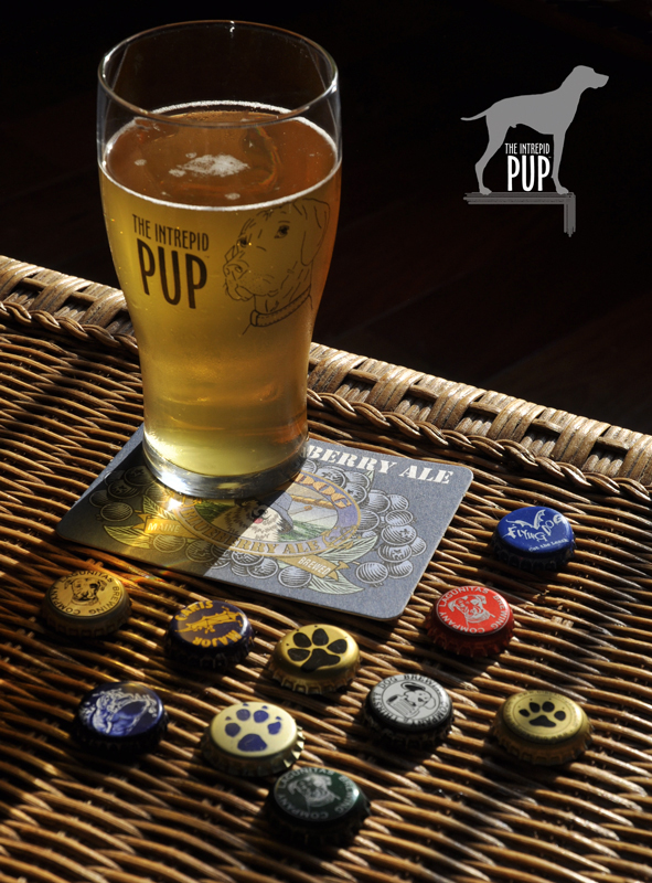 Intrepid Pup pint glass and bottle caps from dog-inspired brews